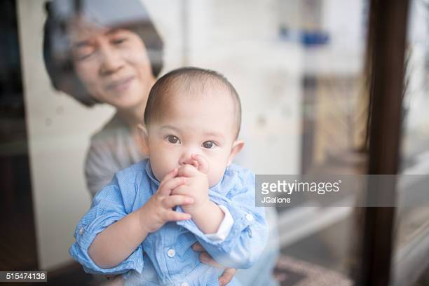 Grandmother playing with her granddaughter
