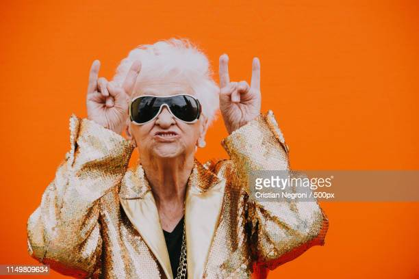 grandmother portraits on colored backgrounds - mamie humour photos et images de collection
