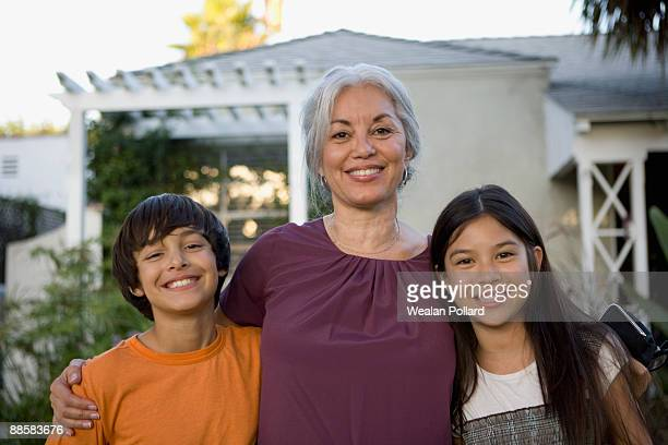 grandmother posing with grandchildren - pacific islanders stock pictures, royalty-free photos & images