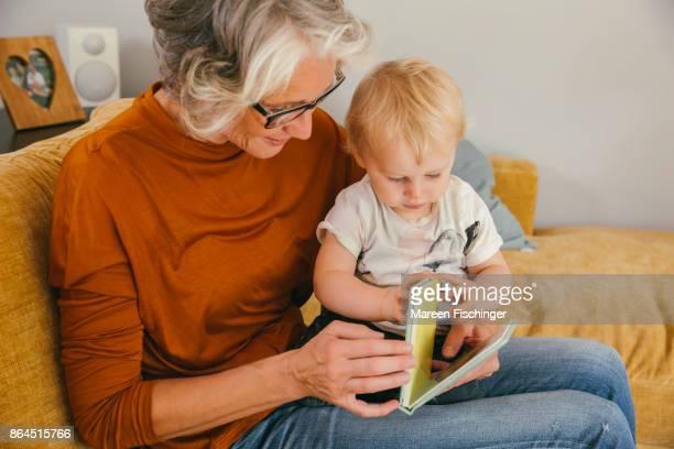 Grandmother reading to her baby grandchild