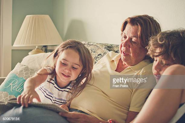 Grandmother reading to her grandchildren.