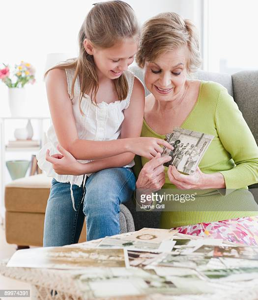 Grandmother showing granddaughter old photos