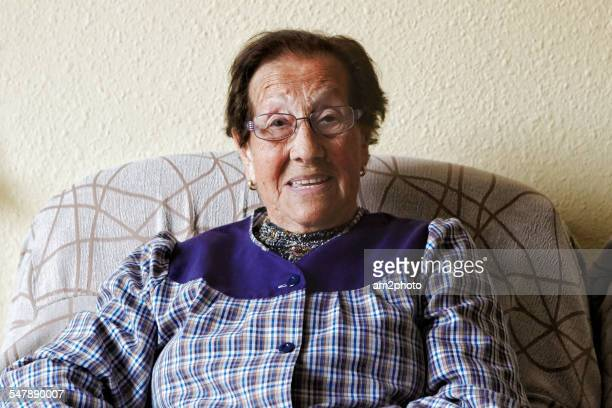 Grandmother smiling in the sofa