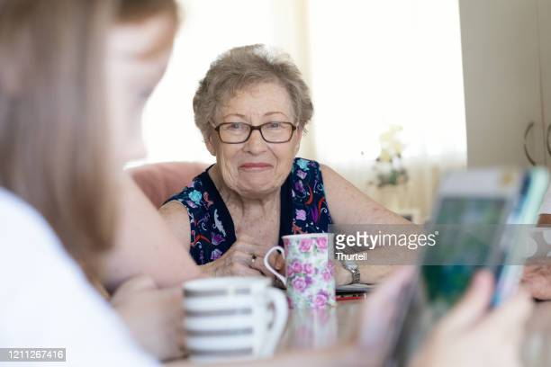 grandmother smiling - human relationship stock pictures, royalty-free photos & images