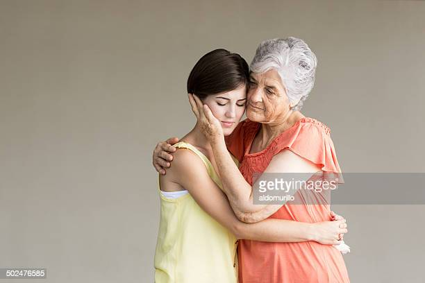 Grandmother supporting granddaughter