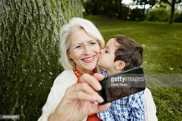 Grandmother taking selfie with grandson