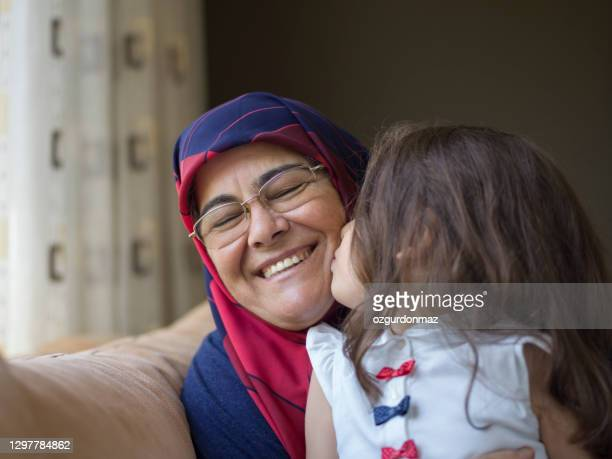 grandmother together with her granddaughter at home, close up portrait - 60 64 years stock pictures, royalty-free photos & images