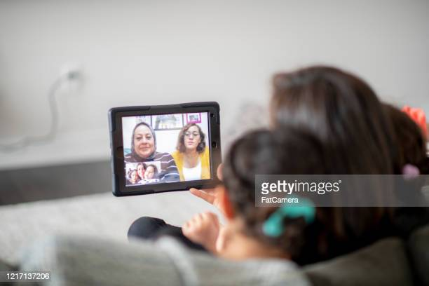 grandmother video calls her family. - islam stock pictures, royalty-free photos & images