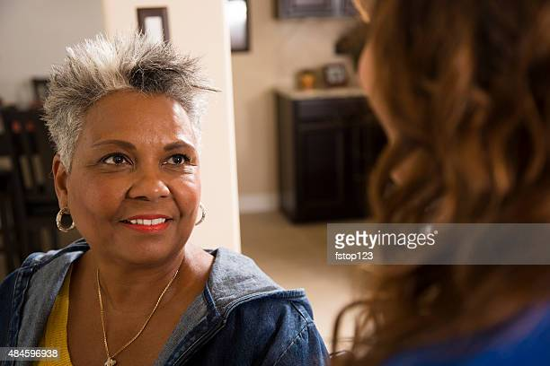 Grandmother visits with granddaughter in a nursing home.