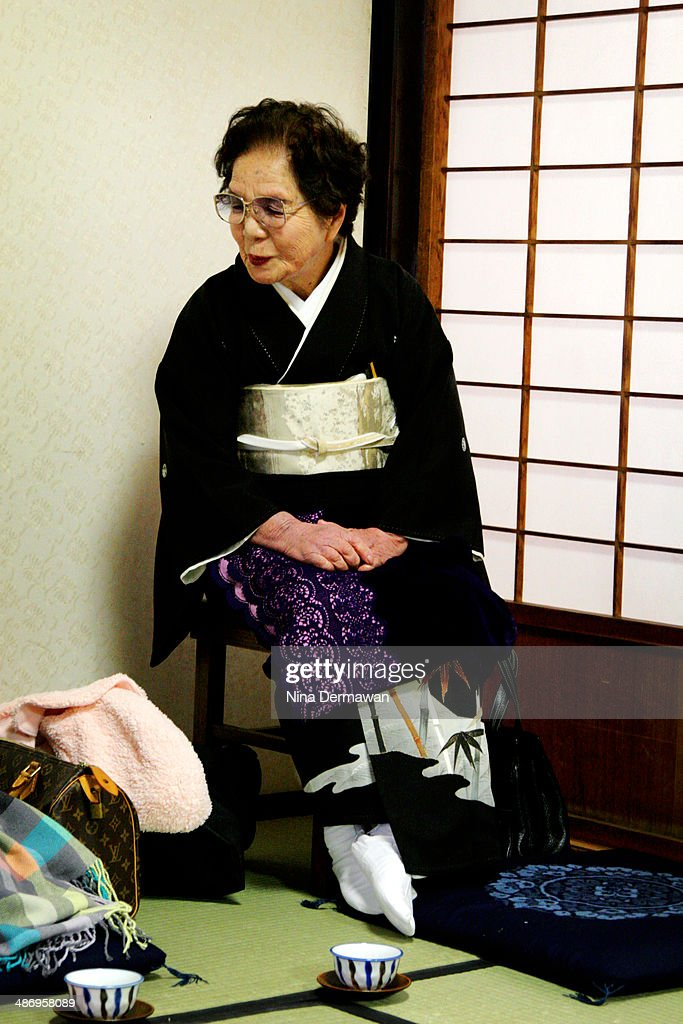 A grandmother waiting for a granddaughter's traditional Japanese wedding ceremony to start.