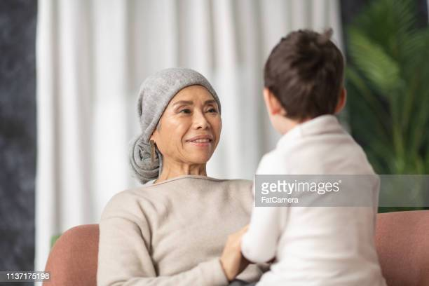 grandmother with cancer playing with her grandson - fat granny stock pictures, royalty-free photos & images