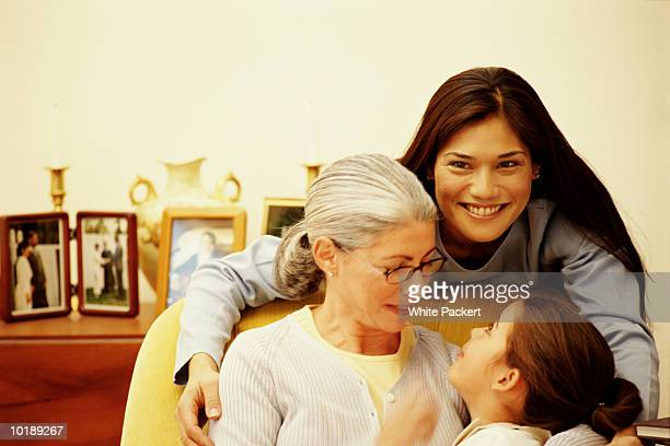 grandmother with daughter and granddaughter (6-8 years) , portrait - 55 59 years stock pictures, royalty-free photos & images