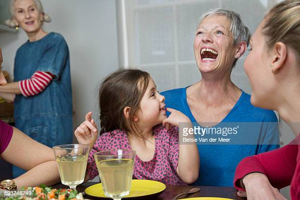 grandmother with grandchild and family at table. - british granny stock photos and pictures