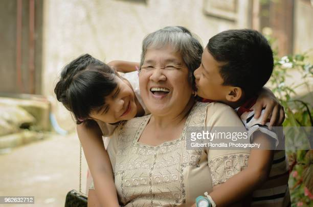 grandmother with grandchildren - filipino culture stock photos and pictures