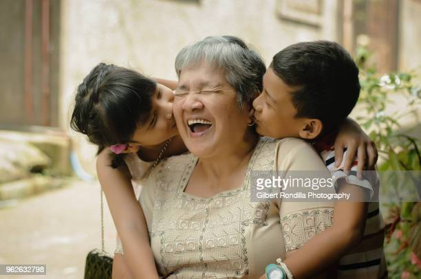 grandmother with grandchildren - filipino culture stock pictures, royalty-free photos & images
