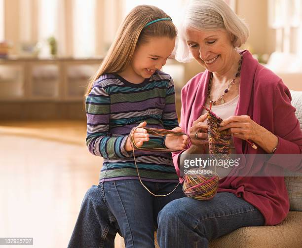 Grandmother with granddaughter getting ready to knit