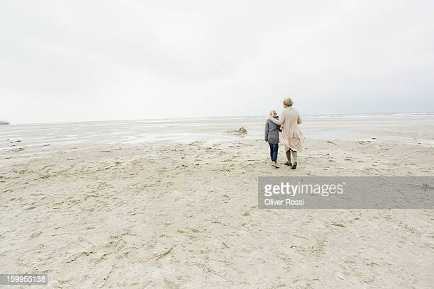 Grandmother with granddaughter on the beach