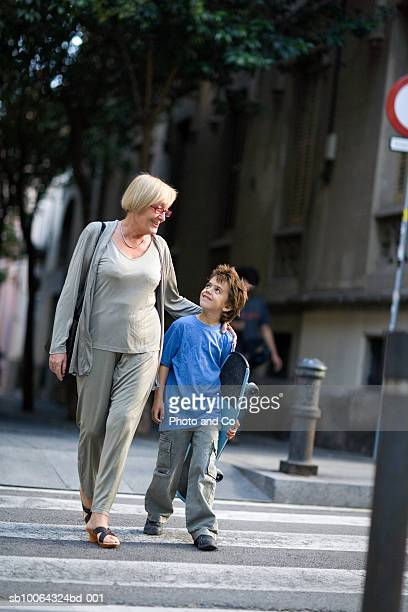 Grandmother with grandson (6-7) crossing street