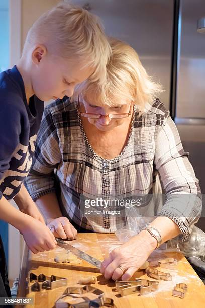 Grandmother with grandson preparing cookies