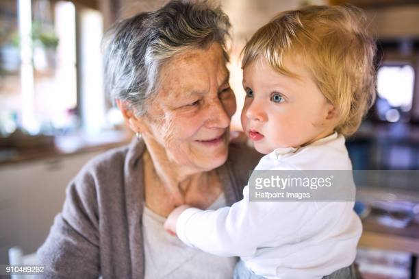 Grandmother with her grandson at home.