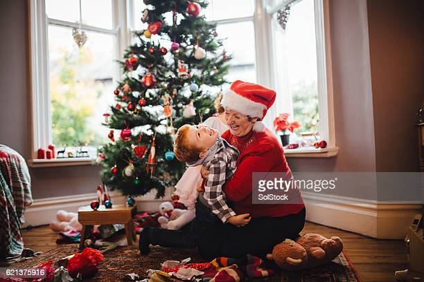 grandmother with her grandson on christmas day - british granny stock photos and pictures