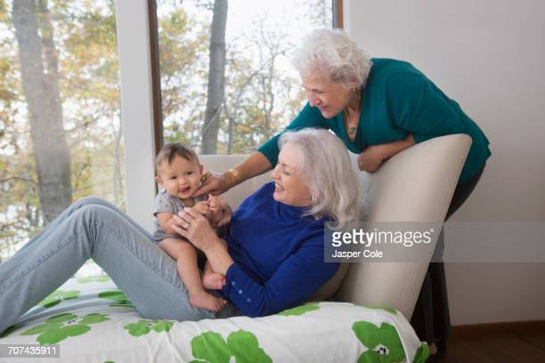 Grandmothers playing with baby grandson