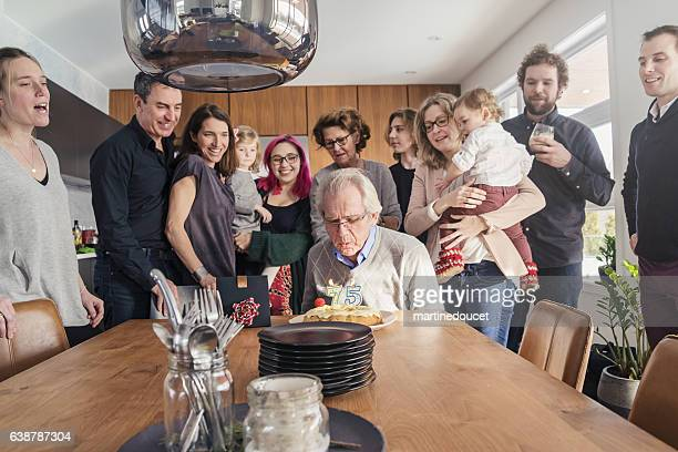 """grandpa 75th birthday celebration with three generation family at home. - """"martine doucet"""" or martinedoucet stock pictures, royalty-free photos & images"""