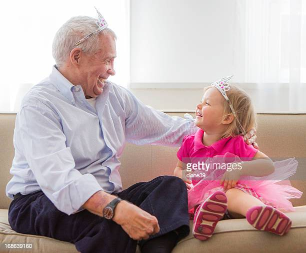 Grandpa and grandaughter playing princess