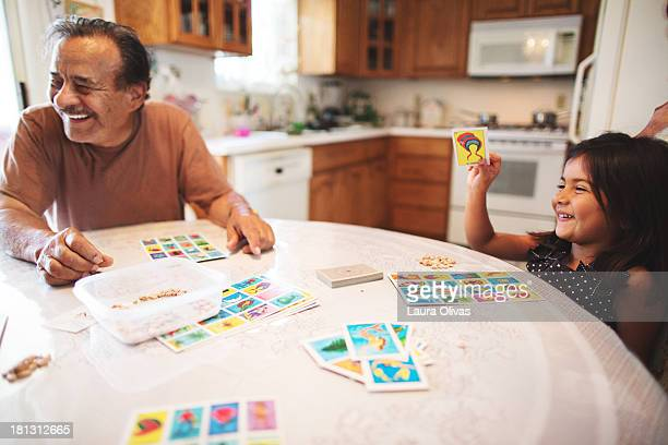 grandpa and granddaughter play a board game - board game stock pictures, royalty-free photos & images
