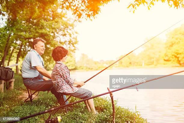 Grandpa and grandson fishing together.