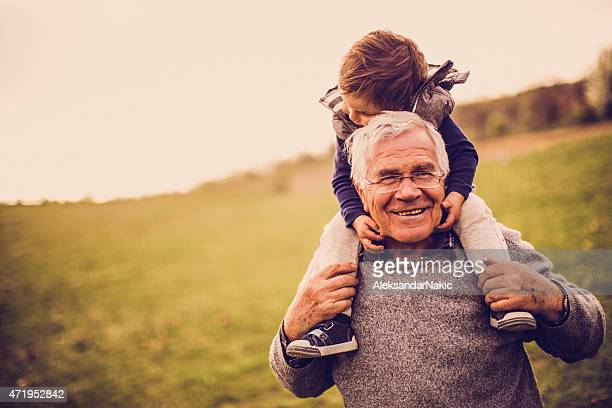 grandpa and me - piggyback stock pictures, royalty-free photos & images