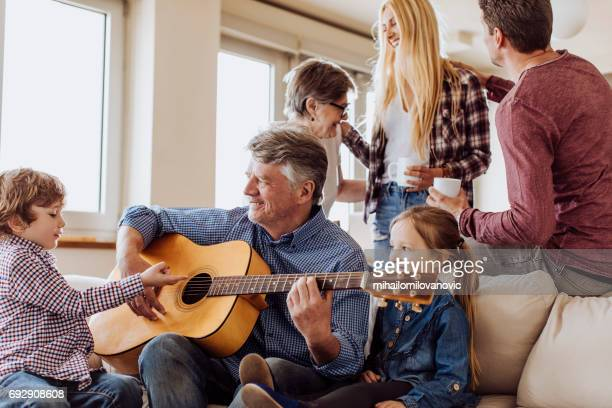 grandpa enjoying with family - beautiful granny stock photos and pictures
