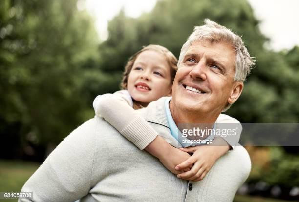 grandpa enjoys bringing her to the park - cavalitas imagens e fotografias de stock
