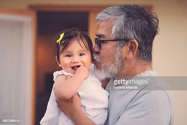 Grandpa Holds Baby Girl