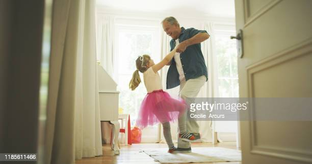 grandpa knows just how to make her feel like royalty - princess stock pictures, royalty-free photos & images
