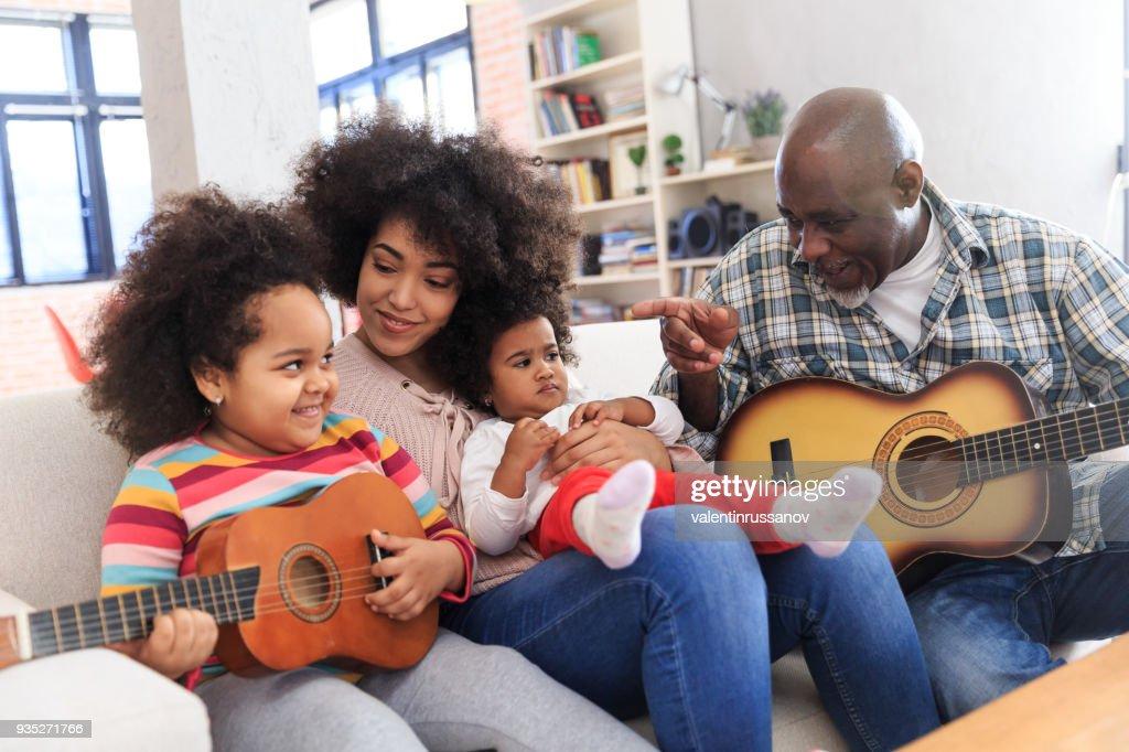 Grandpa plays guitar : Stock Photo