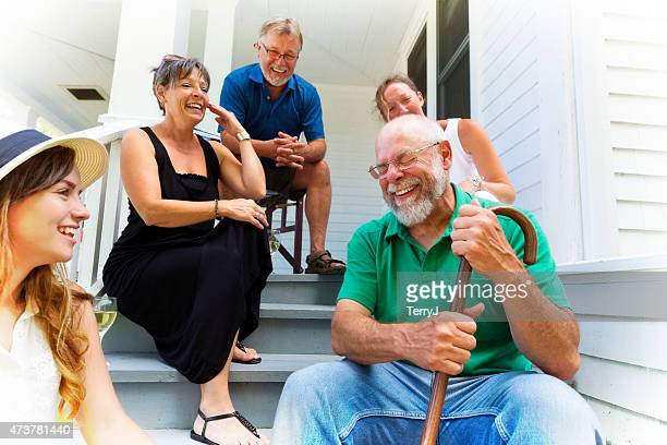 grandpa tells funny story to friends and family - walking cane stock photos and pictures