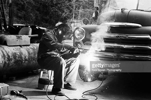 Grandpa welding away on his vintage truck.