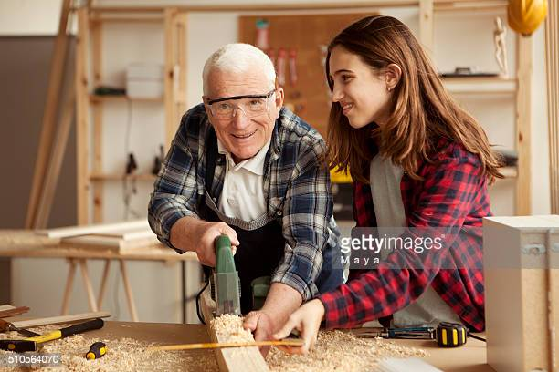 Grandpa with granddaughter at workshop