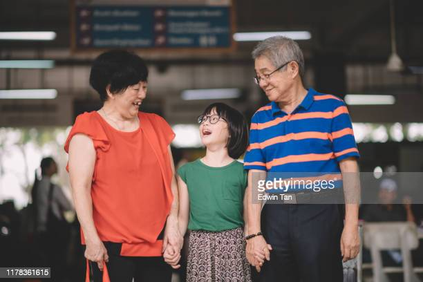 grandparent and their granddaughter at wet market shopping bonding time candid moment