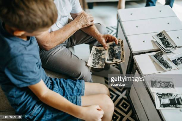grandparent spending time with grandson - the past stock pictures, royalty-free photos & images