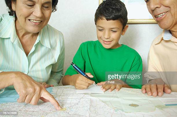 Grandparents and Boy Reading Map