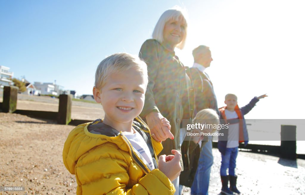 Grandparents and grandchildren at the beach : Stock Photo