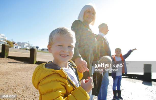 grandparents and grandchildren at the beach - british granny stock photos and pictures