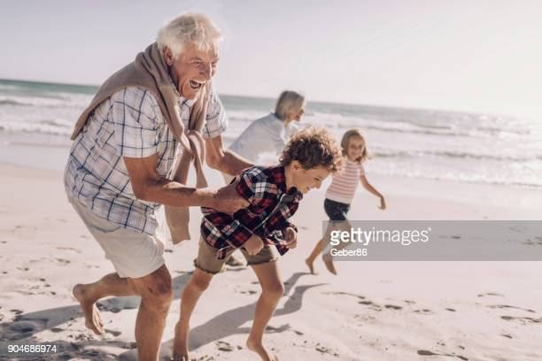 grandparents and grandchildren - granddaughter stock pictures, royalty-free photos & images