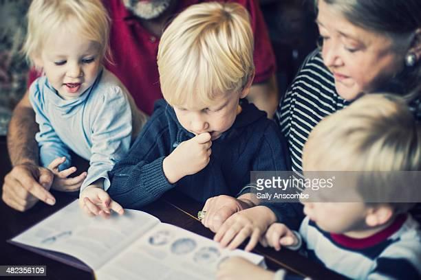 Grandparents and Grandchildren reading a book
