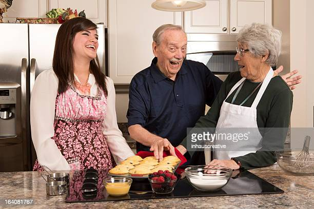 Grandparents and Granddaughter cooking in kitchen