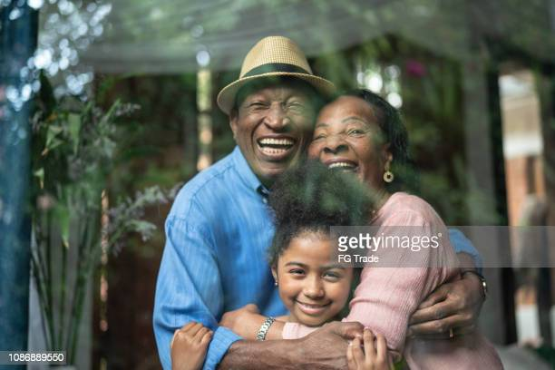 grandparents and granddaughter together portrait - black granny stock photos and pictures