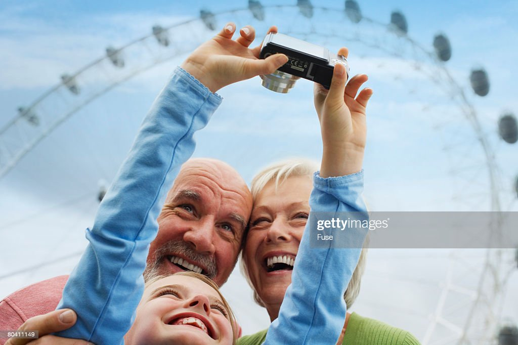 Grandparents and Granddaughter with Digital Camera : Stock Photo