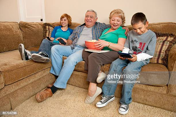 Grandparents and grandkids relaxing on couch